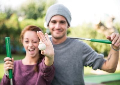 young couple while playing golf
